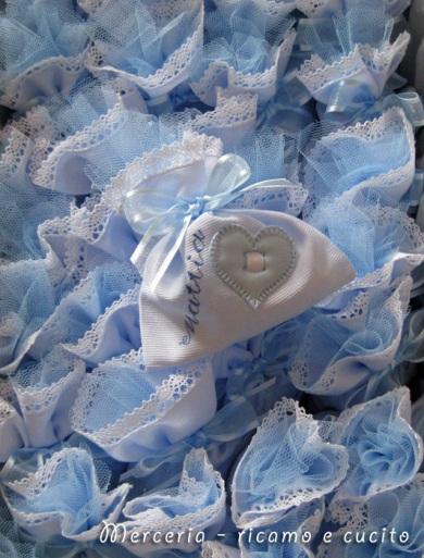 sacchettini-bomboniere-portaconfetti-celeste-con-cuore-per-Mattia