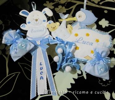 Fiocco nascita cicogna e coniglio, sacchettini bomboniera e ciuccio per Luca
