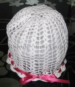 Cuffia cappello con rosellina all'uncinetto per bimba