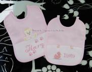 Bavette rosa con orsacchiotto e paperette per Ilary