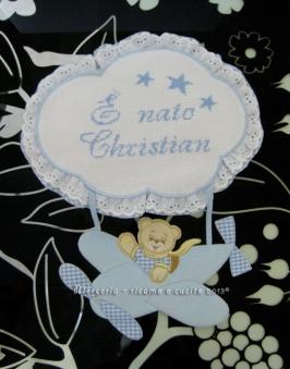 Fiocco nascita aeroplano celeste e bavette per Christian