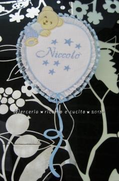 Fiocco nascita palloncino celeste e sacchetti con stelline per Niccolò