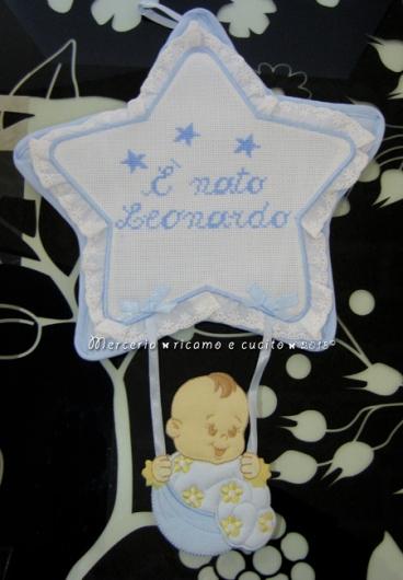 Fiocchi nascita stella e orsetto con cuore celeste per Leonardo