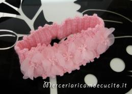 Copertina rosa in lana e fascia capelli in cotone con fiore all'uncinetto