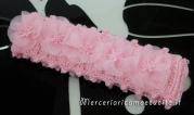 Scarpette e fascie per capelli rosa in cotone all'uncinetto
