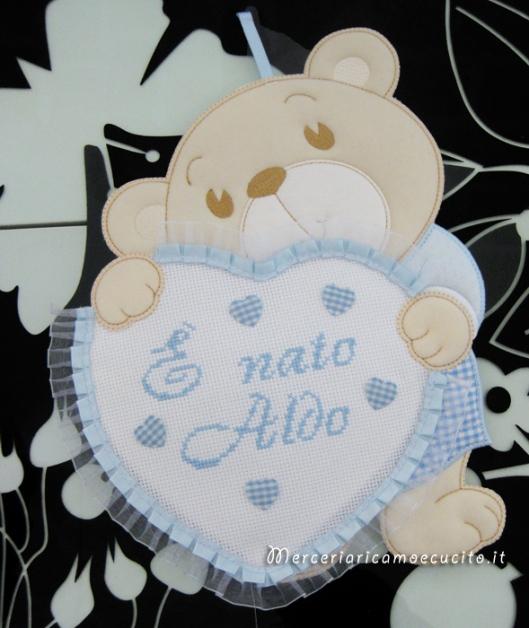Fiocchi nascita e accappatoio per Aldo