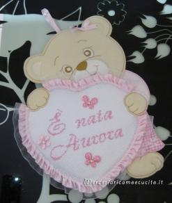 Fiocchi nascita orsetto con cuore e aeroplano per Aurora