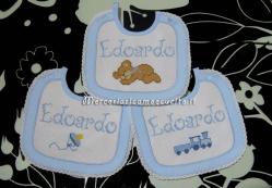 Set corredino per nascita – Sacchetto nascita, bavette, fiocco nascita cicogna e portaciuccio per Edoardo