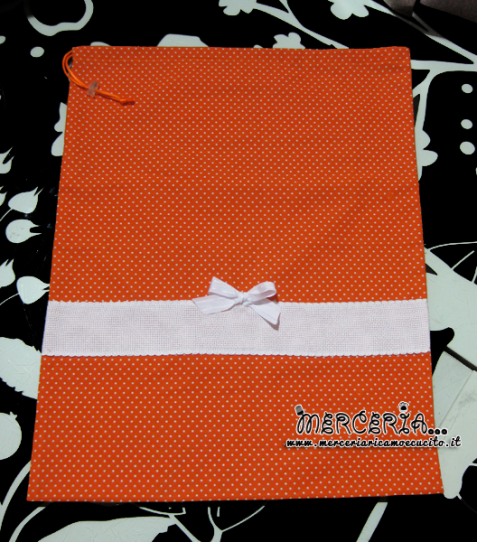 Sacchetti nascita e asilo arancione pois con fiocchetto