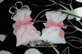 Sacchettini bomboniere portaconfetti rosa con cuore o fiore per Antonia