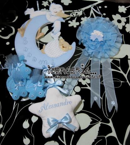 Fiocco nascita luna con cicogna, tulle celeste e bomboniera carrozzina per Alessandro