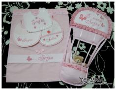 Fiocco nascita mongolfiera rosa, sacco farfalla e bavette prima misura per Sofia