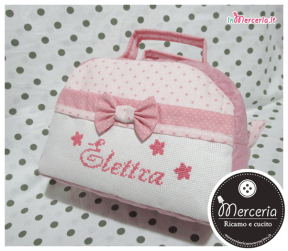 Beauty case stelle con pois rosa e clip portaciuccio per Elettra