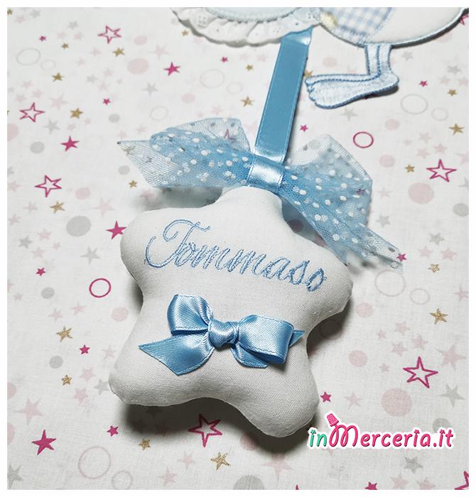 Fiocco nascita cicognetta celeste con stellina per Tommaso